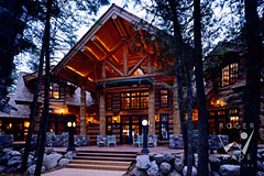 luxury handcrafted log home lodge patio at twilight