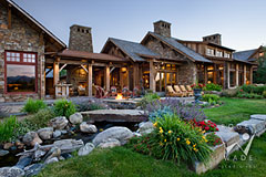 luxury rustic mountain timber frame home with landscaped stream