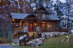 small milled log home cabin with fall colors