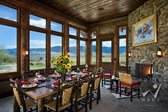 four season porch dining room with fireplace and views of luxury rustic Montana ranch
