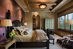 master bedroom of luxury timber frame home in Montana