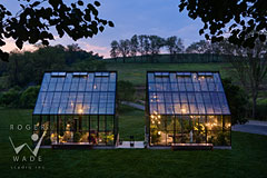 glass and steel greenhouses on Pennsylvania farm at twilight
