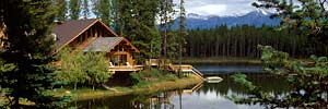 handcrafted log cabin on tranquil mountain lake