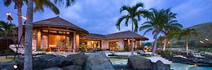 patio view at twilight of luxury Polynesian styled home with retractable walls