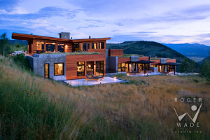 contemporary luxury mountain home at twilight for Architectural Digest