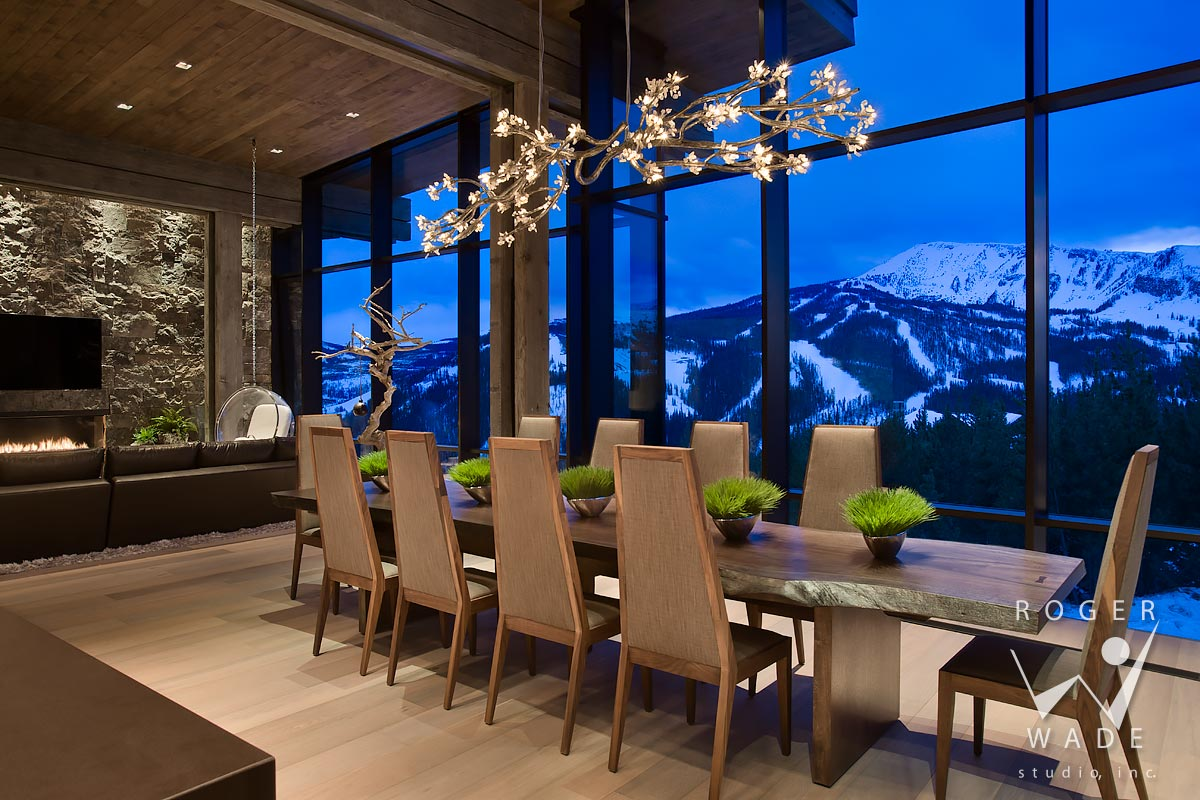 modern interior photograph, dining area looking out windows to mountain view at twilight, yellowstone club, mt