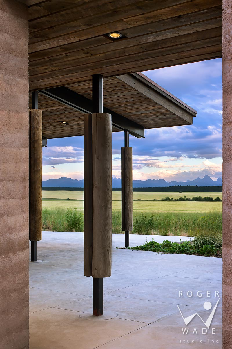 contemporary rustic architecture image, breezeway looking out to farmland and mountains, squirrel, id