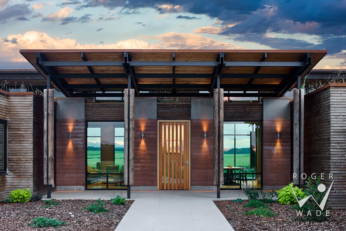 contemporary mountain architecture, front entry detail at twilight, squirrel, id