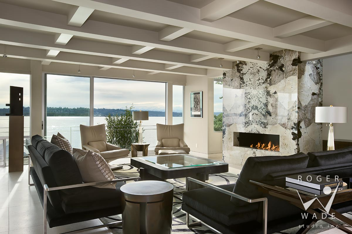modern interior design photography, living room toward fireplace and deck with view of lake washington, kirkland, wa