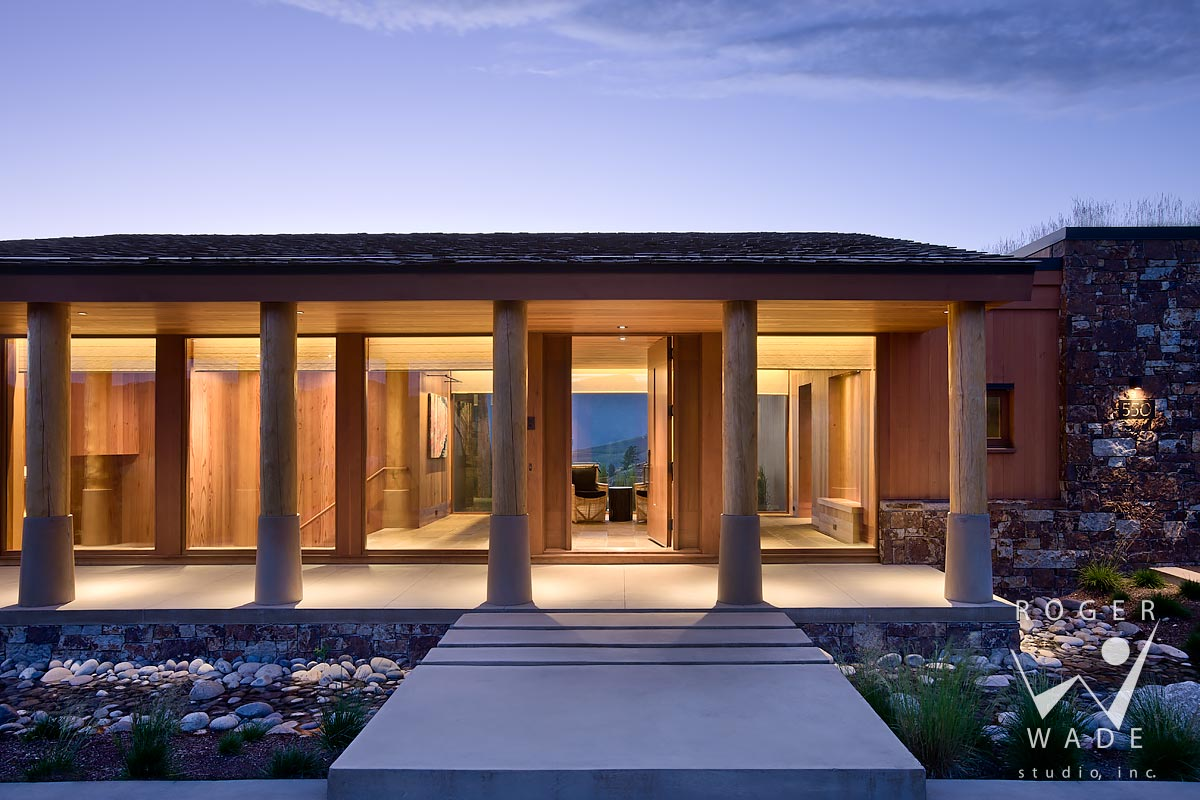 image of modern rustic architecture, front entry at twilight, jackson, wy