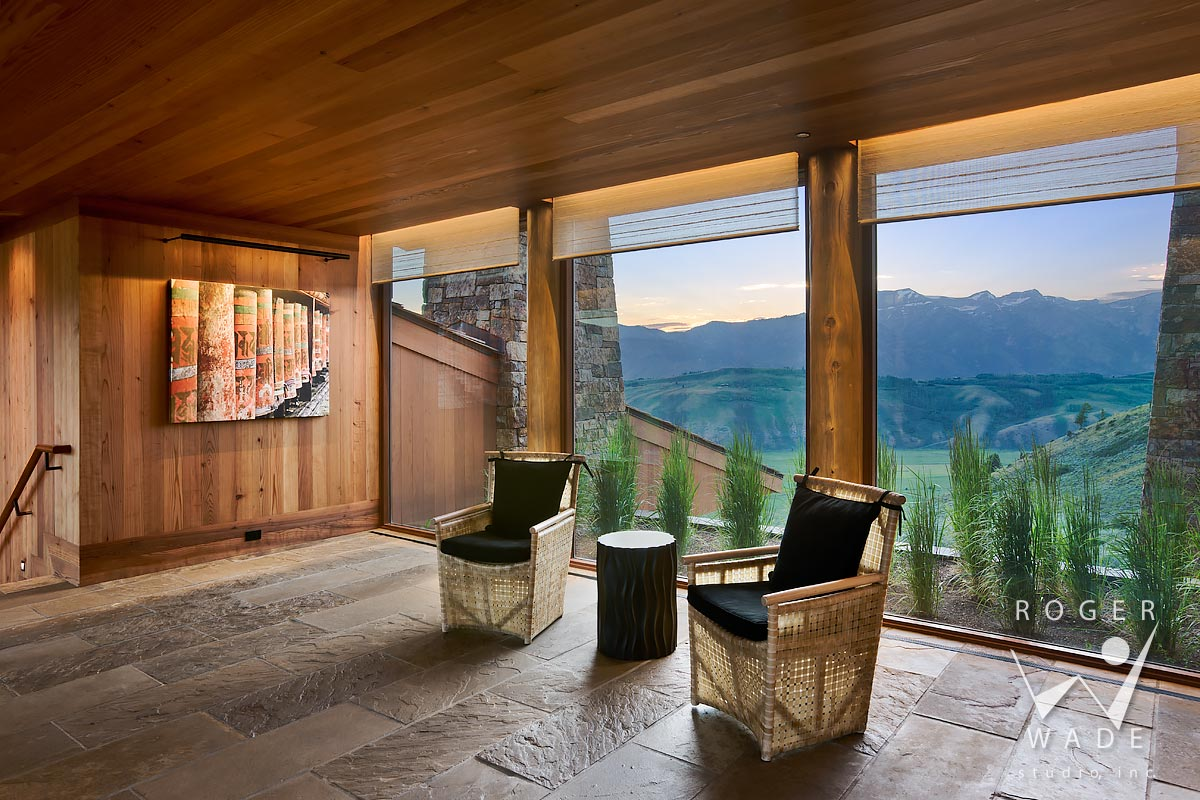 mountain modern interior design photography, entry in evening light, looking out windows to mountain view, jackson, wy