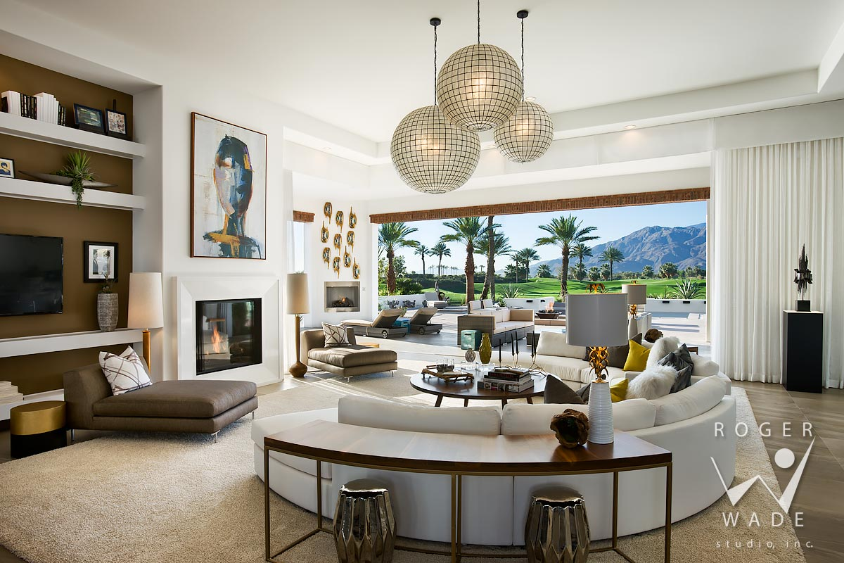 contemporary interior design image, living room looking out to rear patio, pool and golf course with santa rosa mountains in distance, la quinta, ca