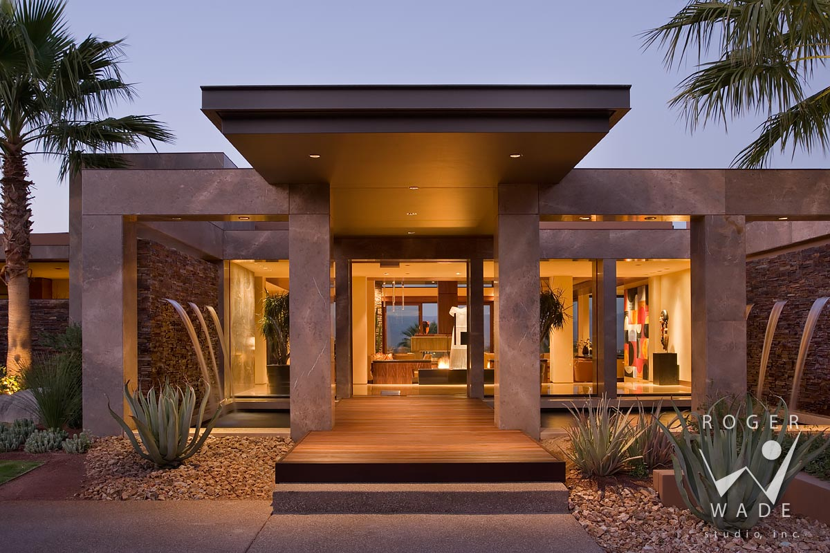 photo of contemporary architecture, front entry with water fountains at twilight, palm desert, ca