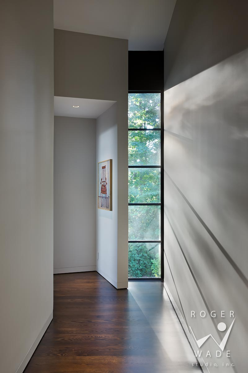 contemporary interior design photography, view from hallway to master bedroom with light streaming through windows, portland, or