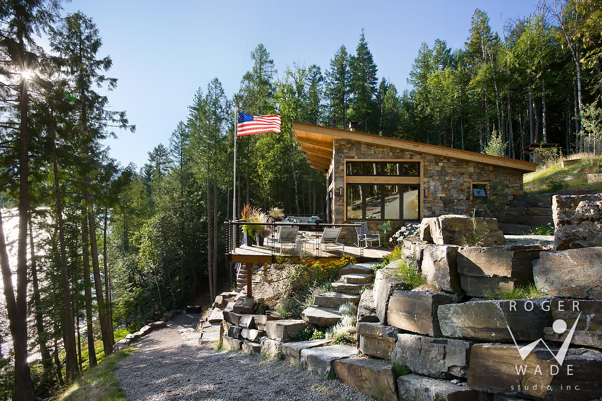 contemporary cabin photo, side elevation showing deck and stone steps, looking out to lake view, swan lake, mt
