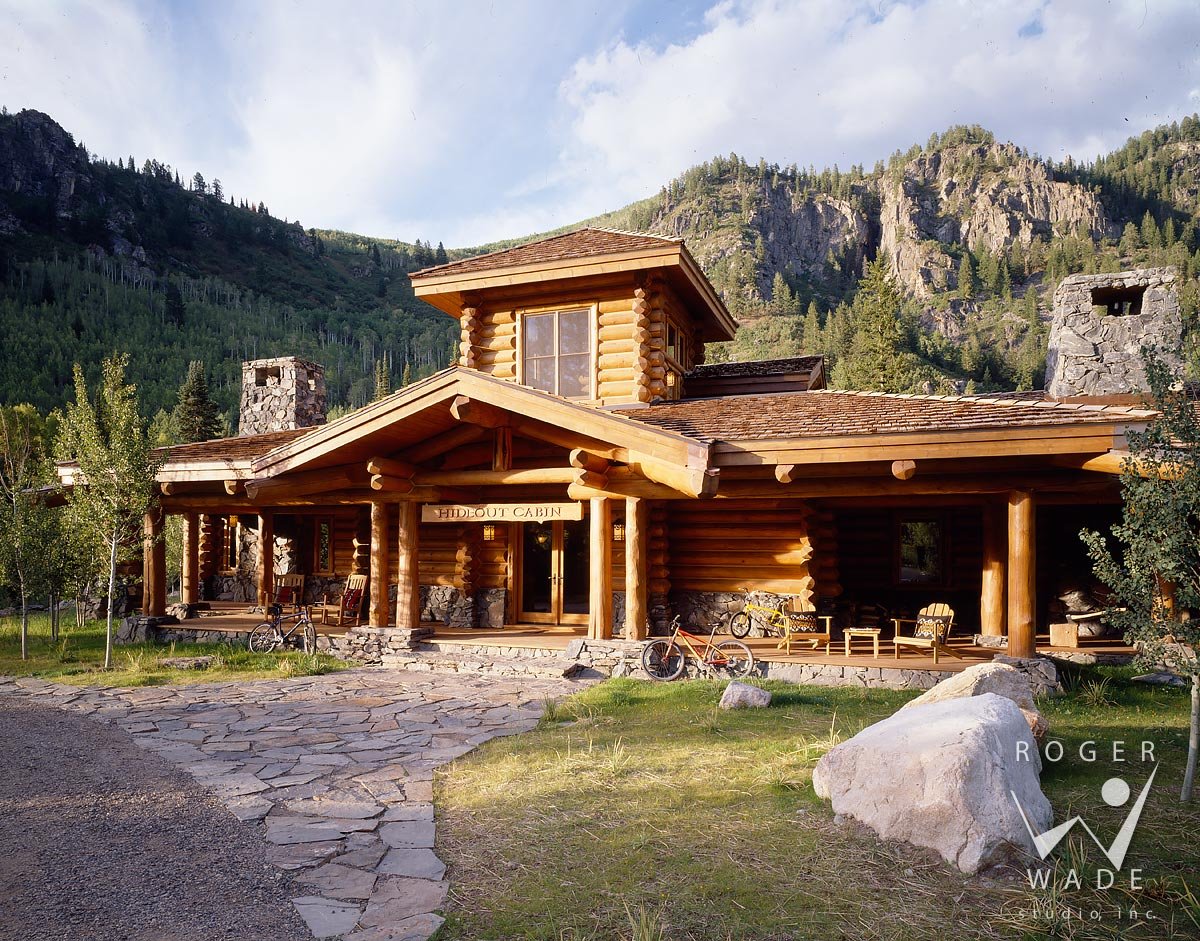 log cabin image, front elevation with mountains in background, steamboat  springs, co