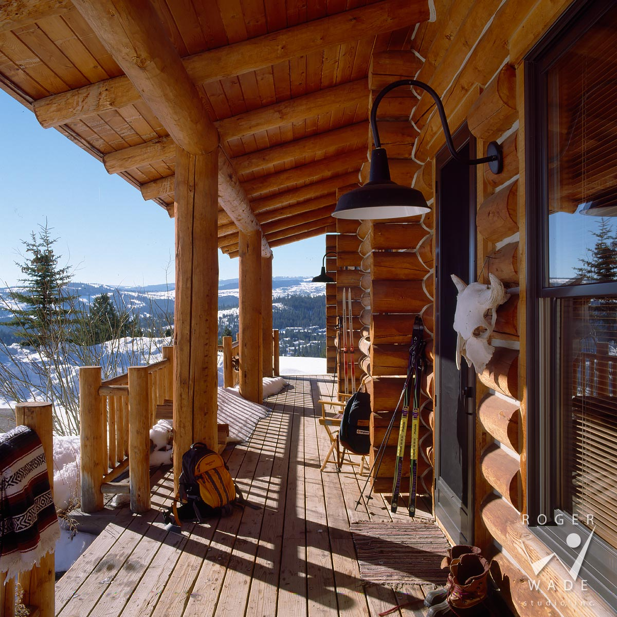 stock image of small cabin front porch and winter view, big sky, mt