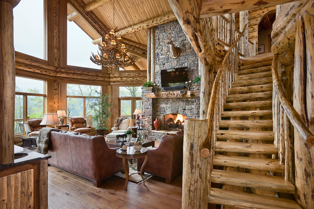 log home photo living room toward stairway fireplace and windows clayton ga - Log Homes Interior Designs