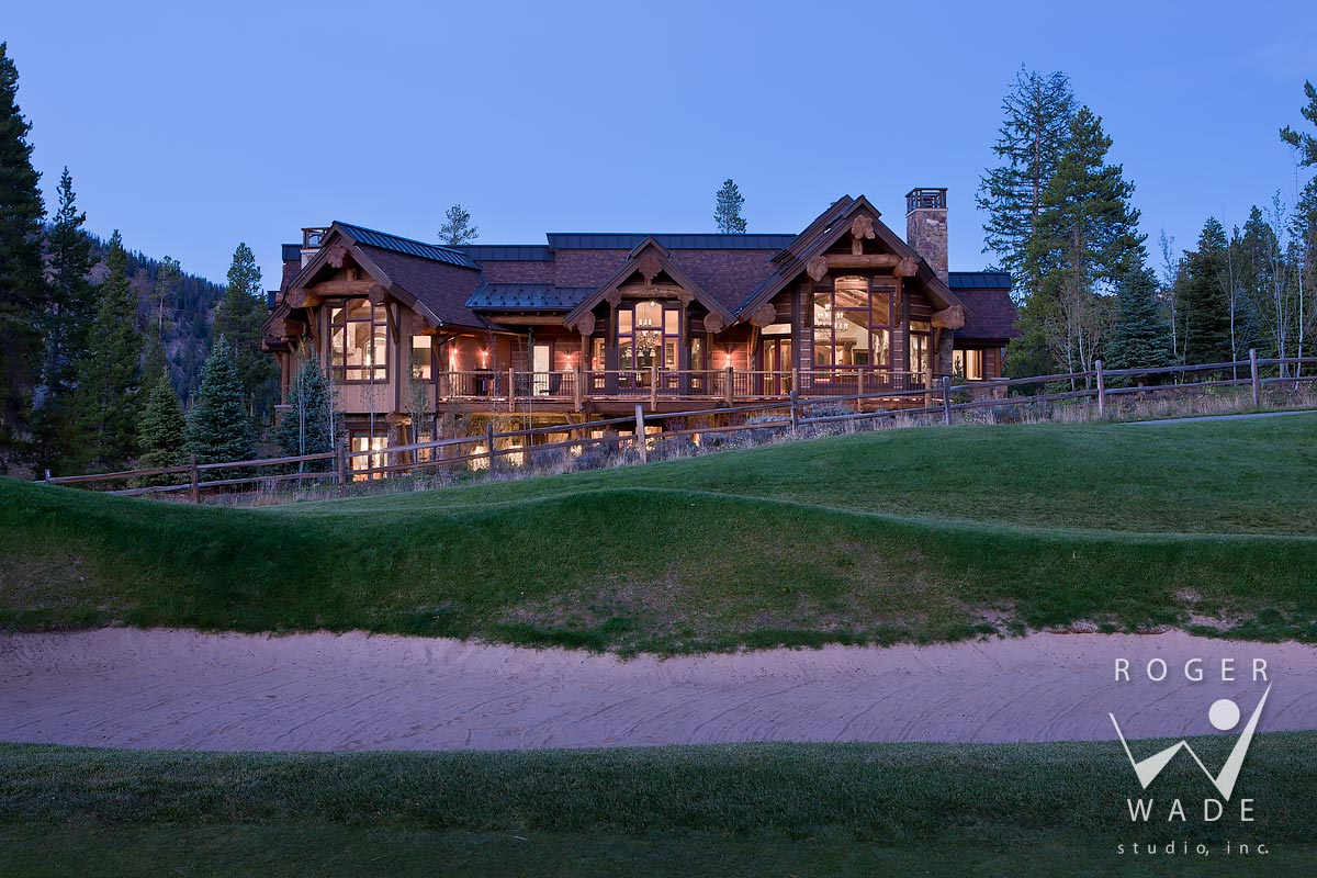 log home photo, rear elevation at twilight from golf course, breckenridge, co