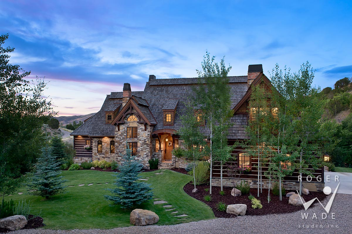 photograph of overall front elevation of hybrid log home at twilight, pocatello, id
