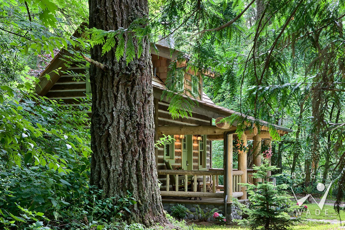 log cabin photo, porch view through trees, port orchard, wa