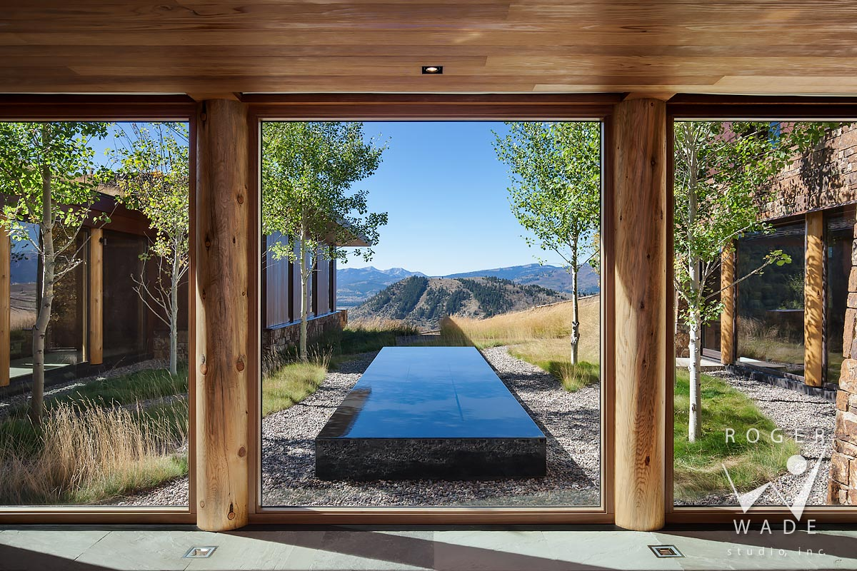 contemporary log home photo, view from foyer looking out to courtyard and mountain view, jackson, wy