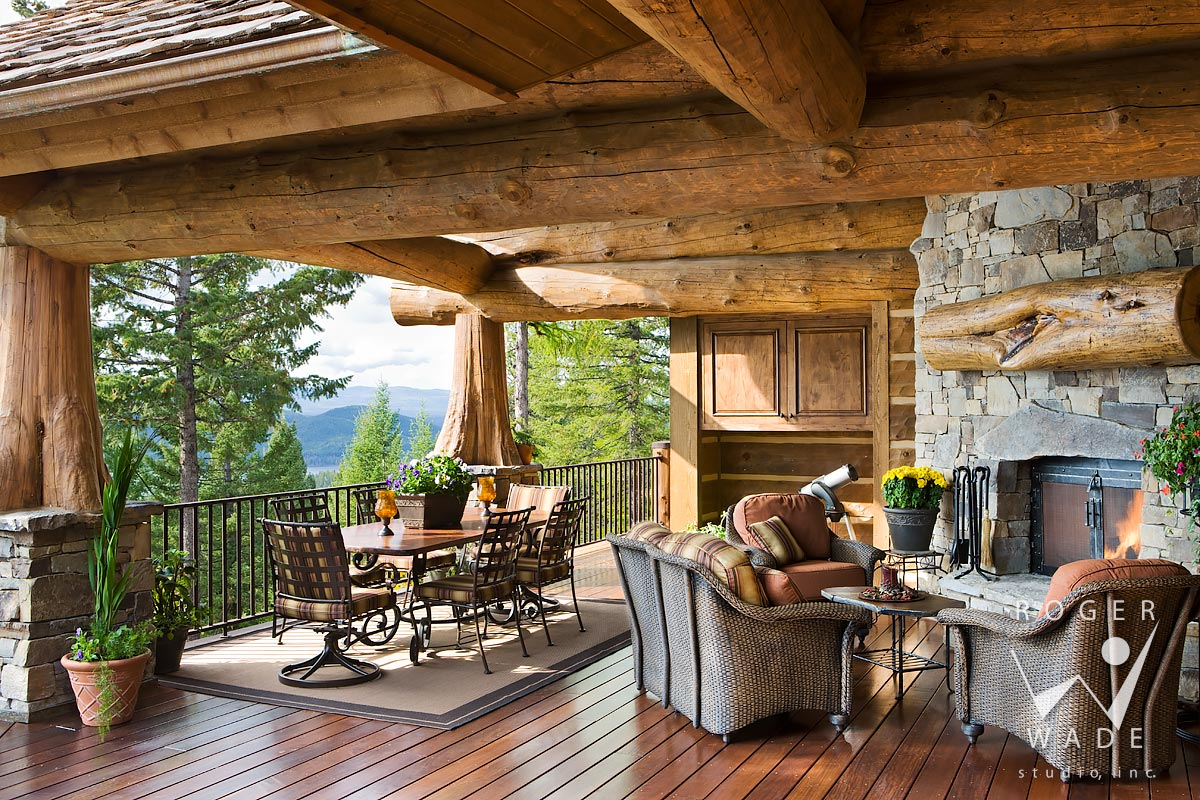 Log Cabin Stock Photo, Rear Covered Deck With Fireplace Looking Out To  Mountain View,