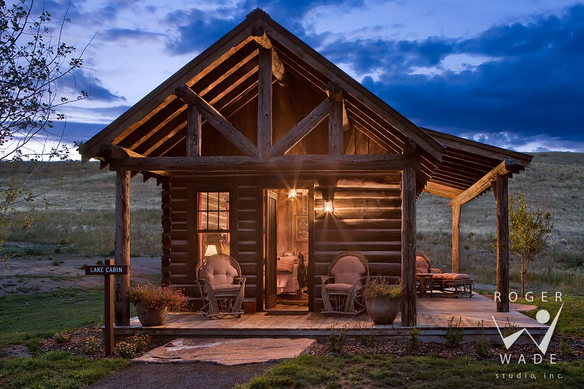 stock photography of small restored cabin at twilight, mcallister, mt
