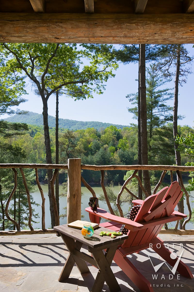 log cabin stock photography, deck with andirondack chair and log railing, looking out to lake view, blue ridge, ga