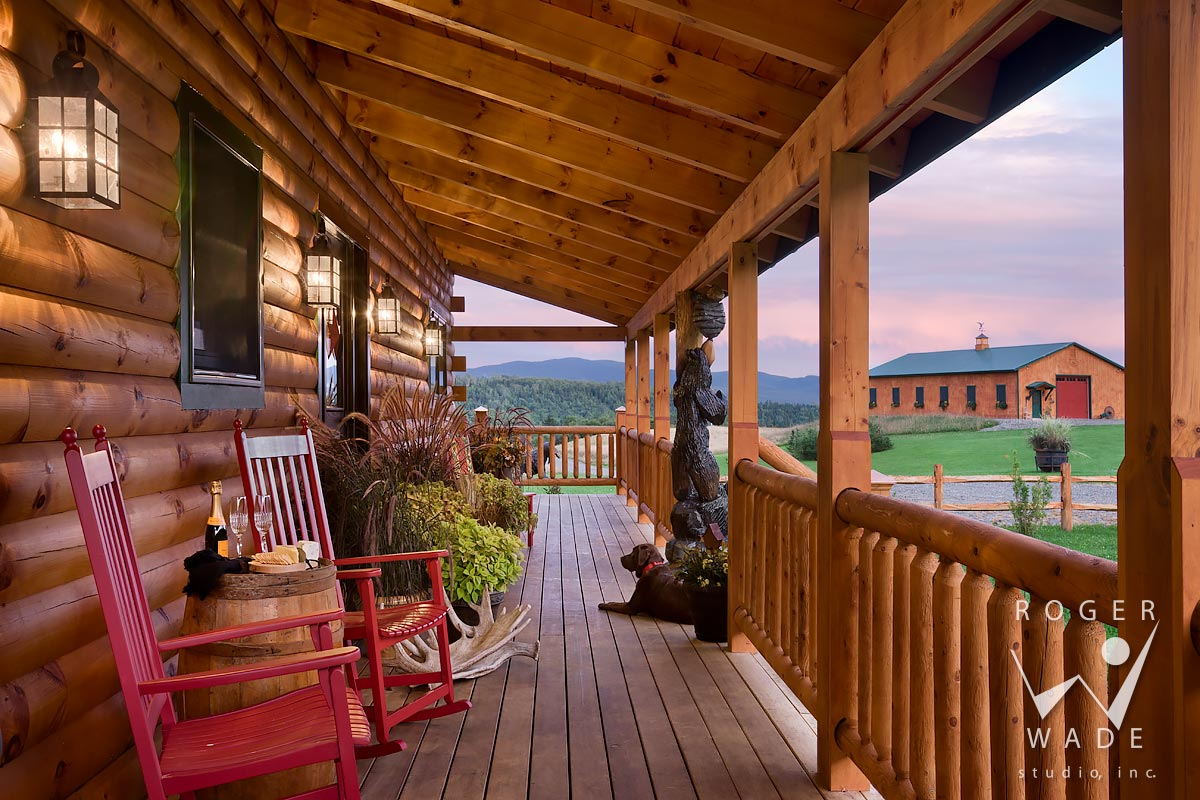 Log Cabin Stock Image, Front Porch With Dog At Twilight, Looking Out To Farm