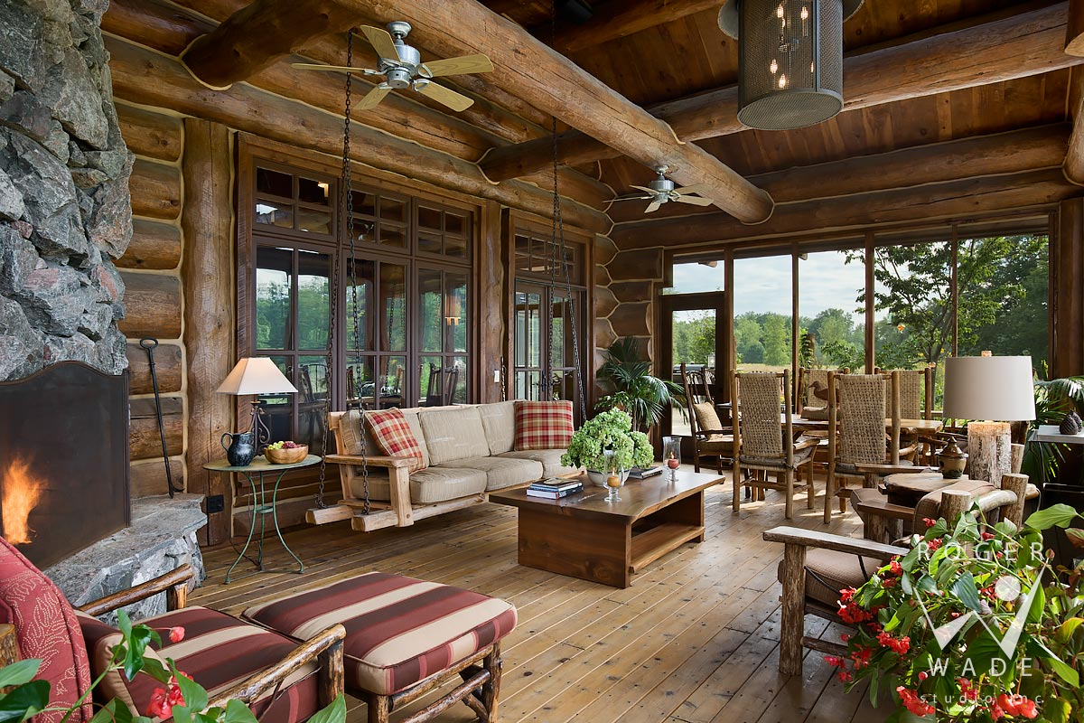 log cabin image, screened porch sitting area with fireplace, lakeside, mi
