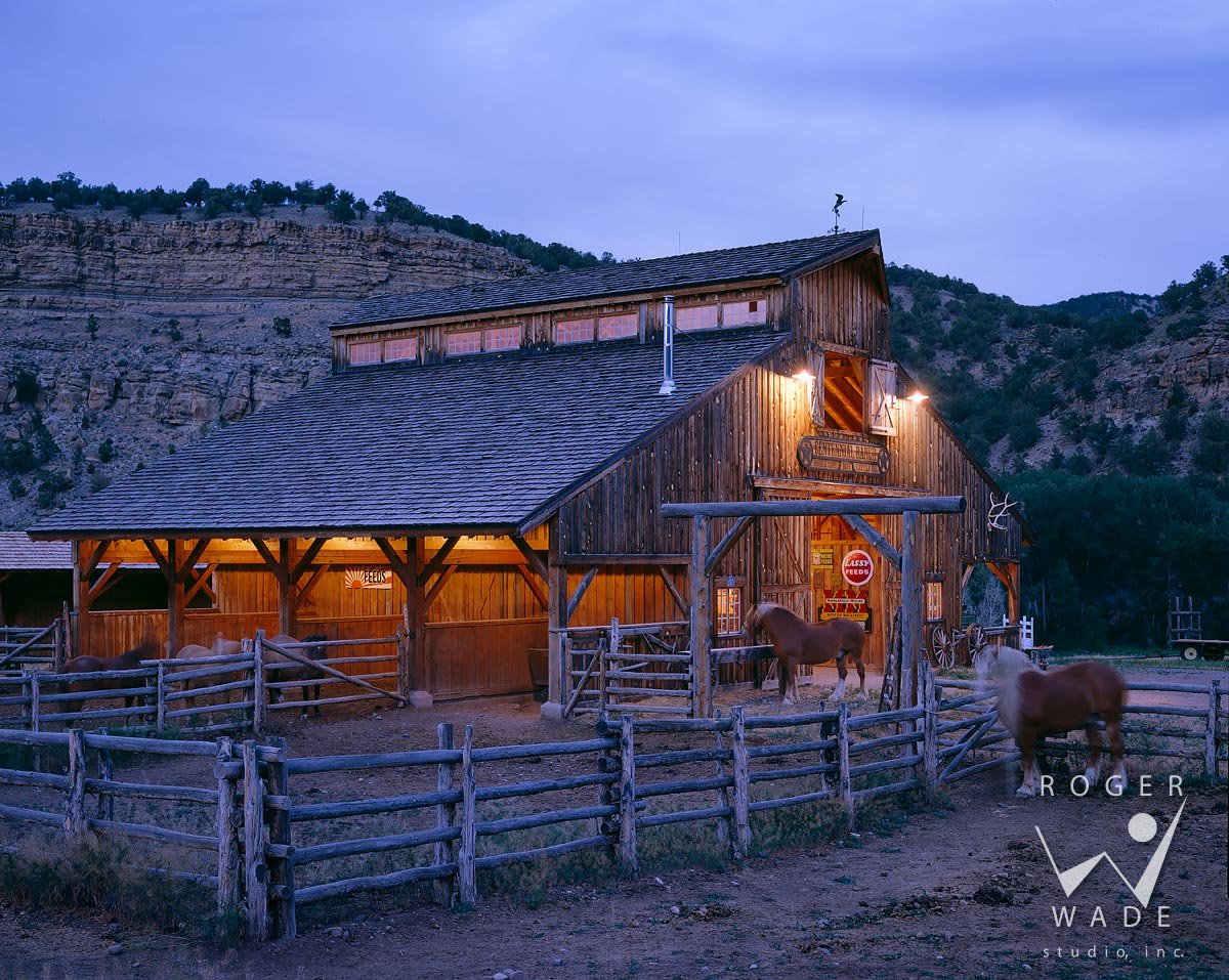 roger wade studio architectural photography of rustic timber frame barn and horses at twilight, private ranch, colona, colorado, photographed for double shoe cattle company