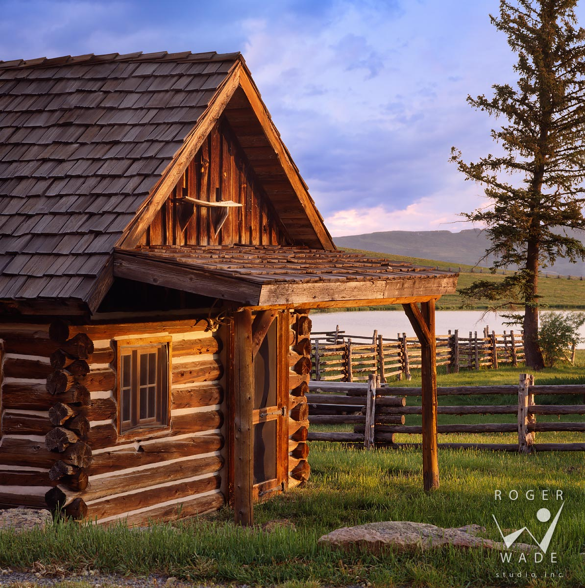 roger wade studio architectural photography of rustic cabin bunk house at twilight, private ranch, ridgway, colorado, photographed for double shoe cattle company
