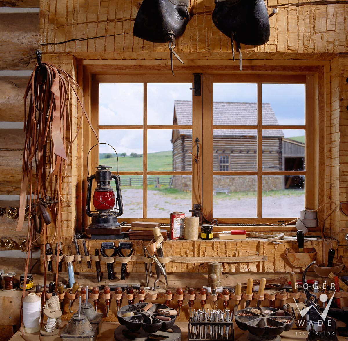 roger wade studio interior photography of rustic cabin leather shop vignette with tools, private ranch, ridgway, colorado, photographed for double shoe cattle company