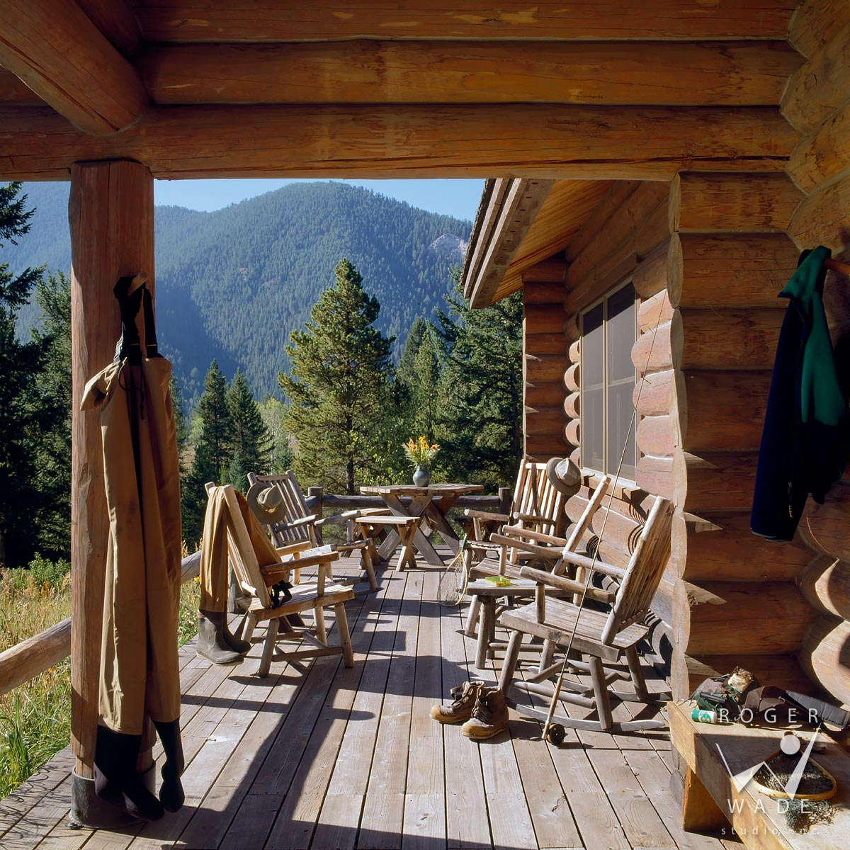 roger wade studio rustic log home photography, porch sitting area looking out to mountain view, private cabin, big sky, montana