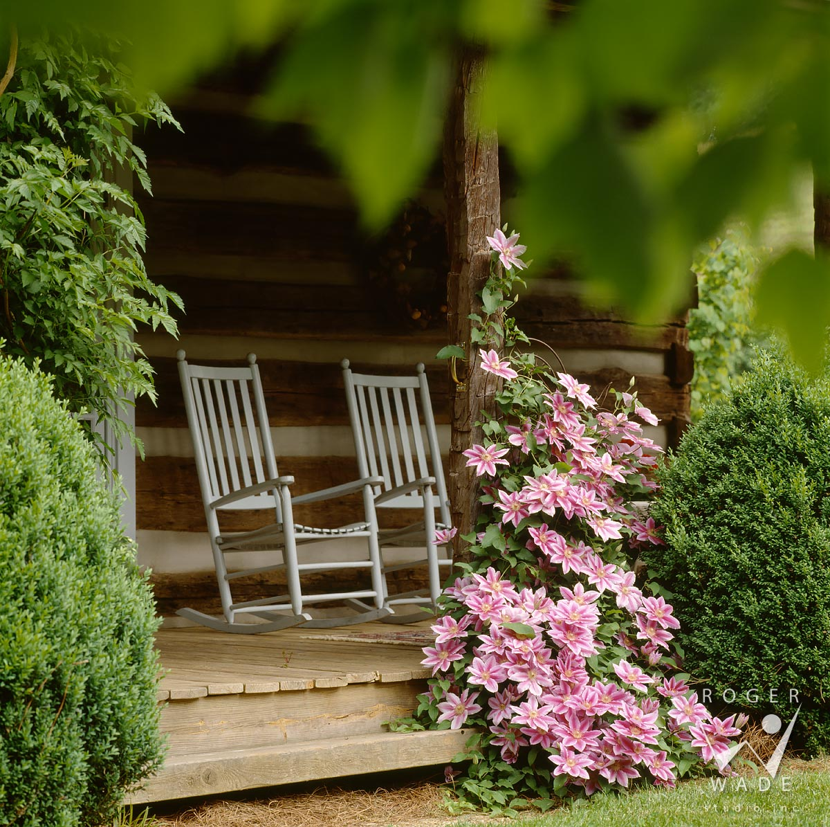 roger wade studio architectural photography of porch vignette with rocking chairs, rustic log home cabin, waynesville, north carolina