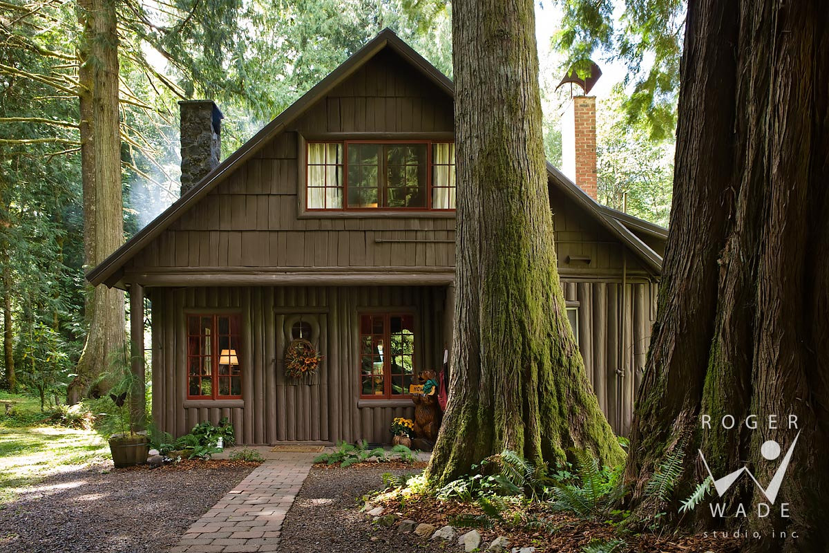 roger wade studio architectural photography of rustic original steiner cabin surrounded by large cedar trees, private residence, rhododendron, oregon