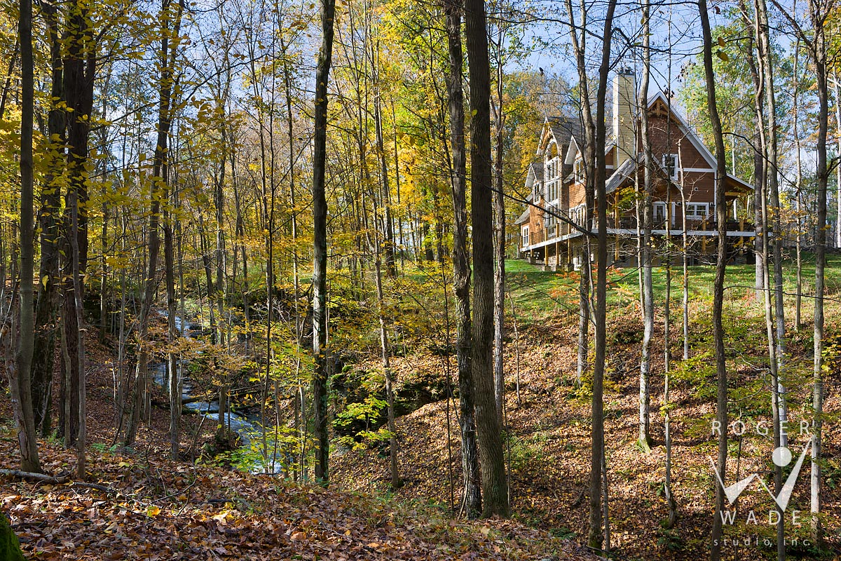 scene setter of house through trees with slate bottomed creek, trumansburg, ny