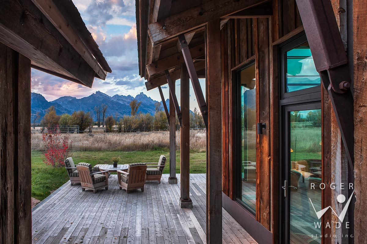 looking out to patio and mountain views at twilight through timber architecture, jackson, wy