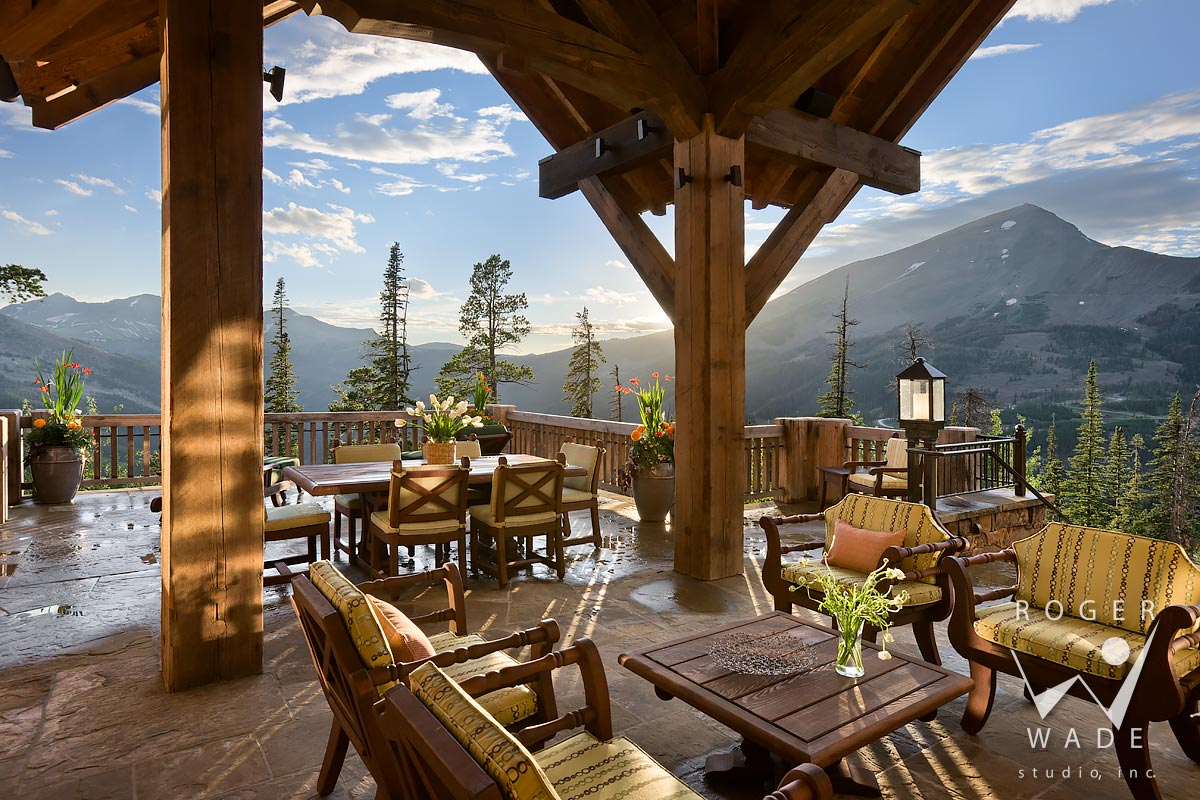 covered patio looking out to lone peak view, yellowstone club, mt