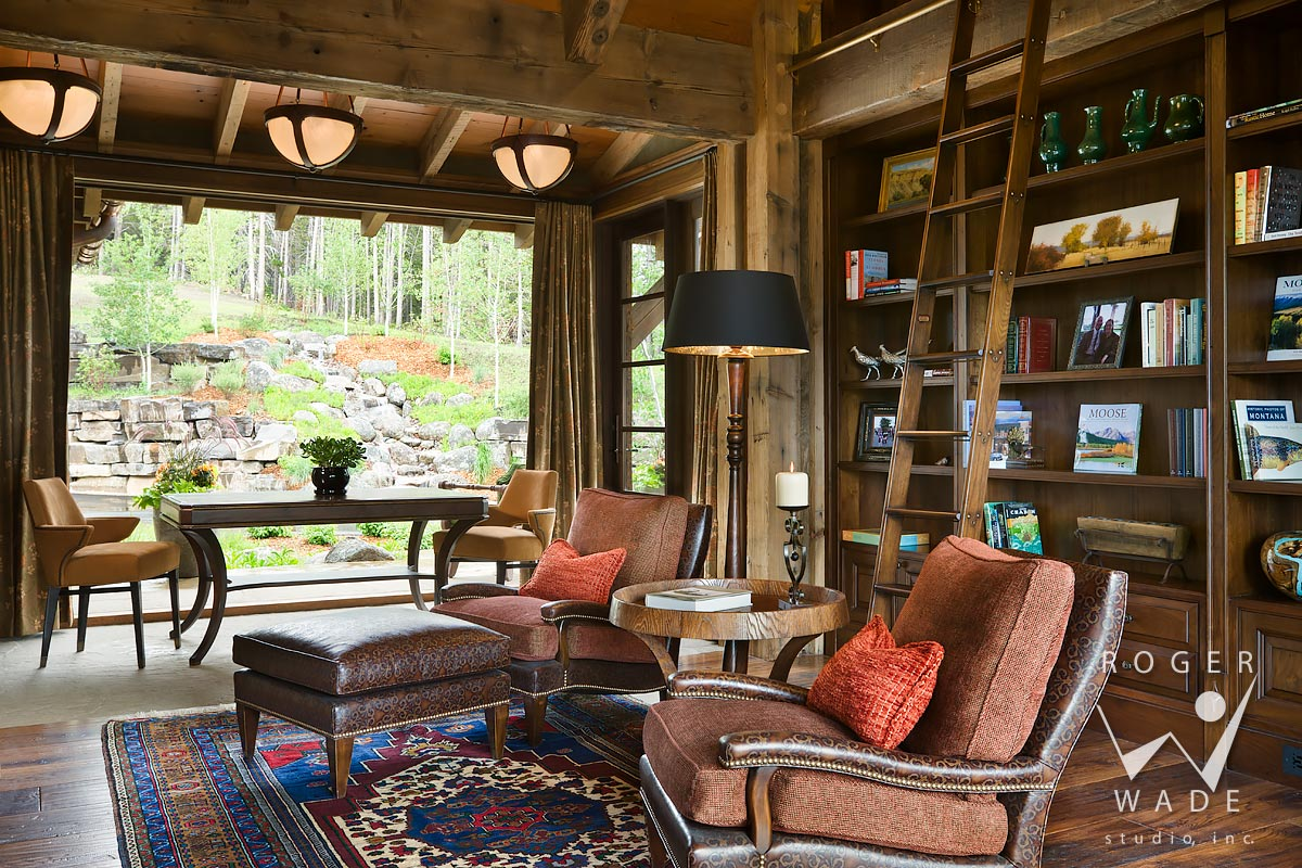 library looking out to waterfall and landscaping, yellowstone club, mt