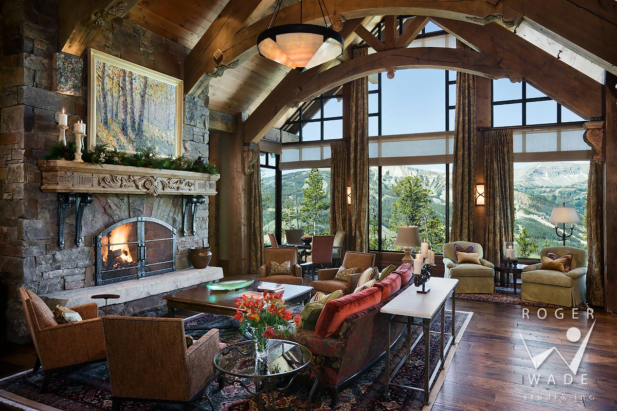 living room toward fireplace and windows looking out to mountain view, yellowstone club, mt