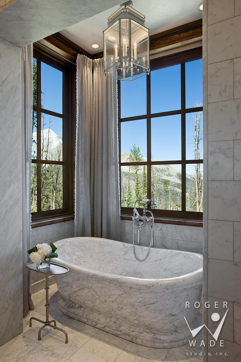 traditional interior design stock image, marble carved tub in luxury bathroom, yellowstone club, mt