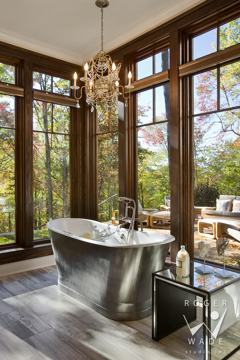 traditional interior photography of luxury bathroom tub looking out windows to fall color, balsam mountain preserve, nc