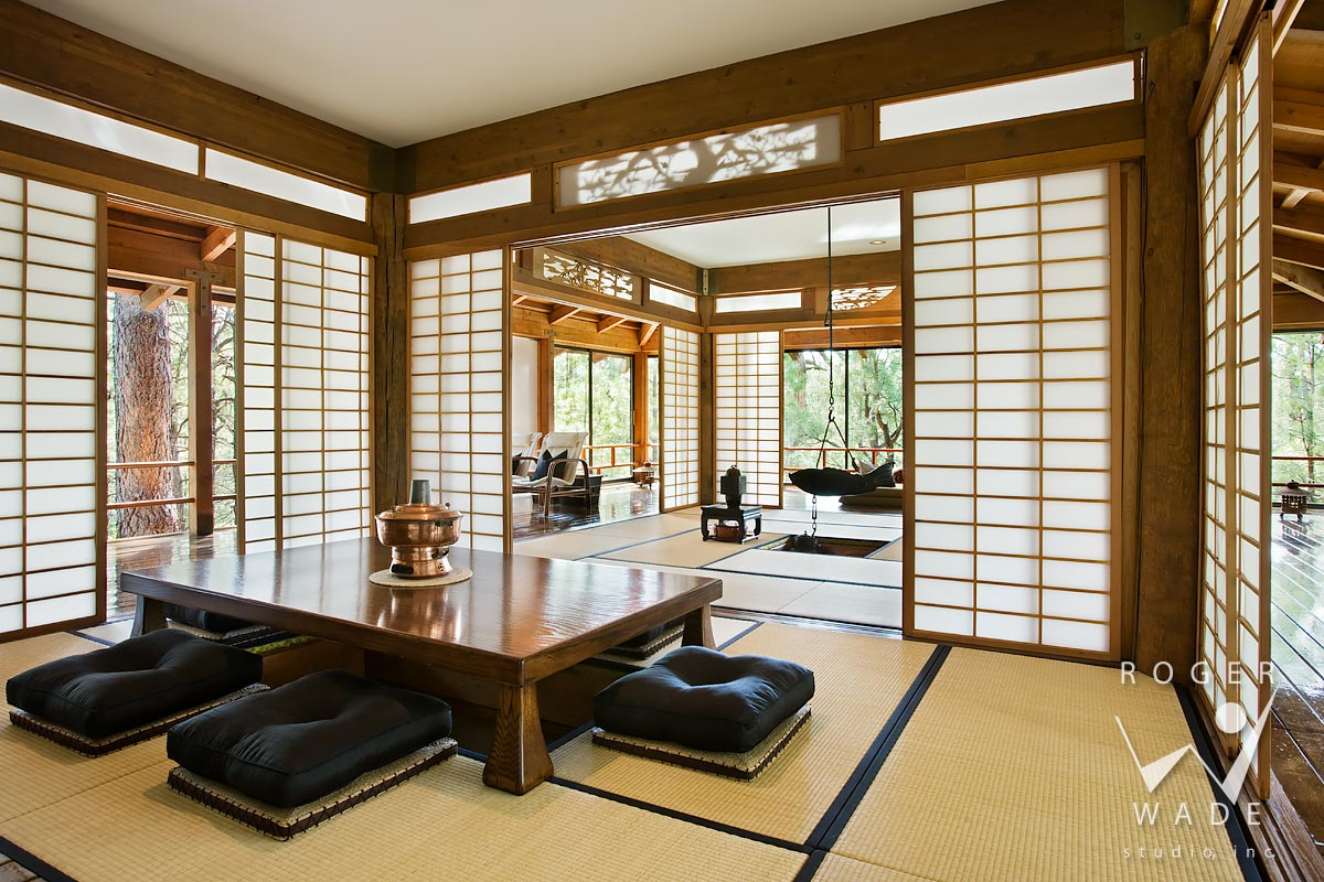 traditional japanese interior design photography, pavillion looking toward engawas with dining area in foreground, forest lakes, az