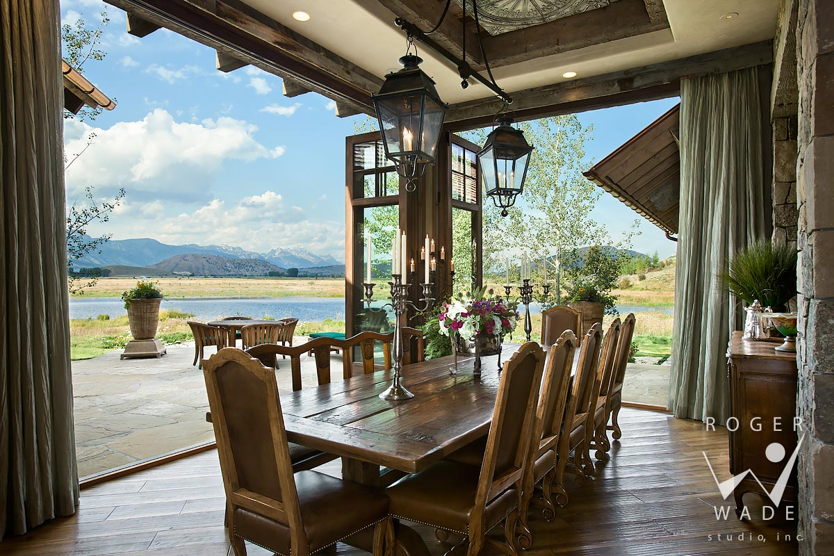 traditional interior design photo, dining room looking out sliding glass walls to ranch view, jackson, wy