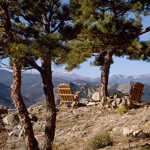 lifestyle scene of adirondack chairs perched atop a rocky Colorado mountaintop